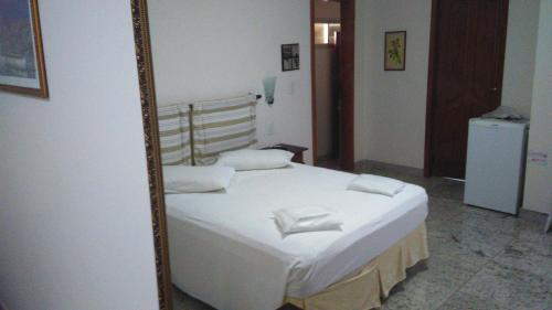 A bed or beds in a room at Villa Norma Suites