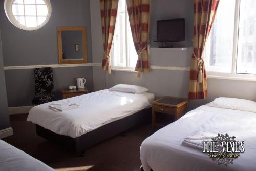 A bed or beds in a room at The Vines (The Big House)