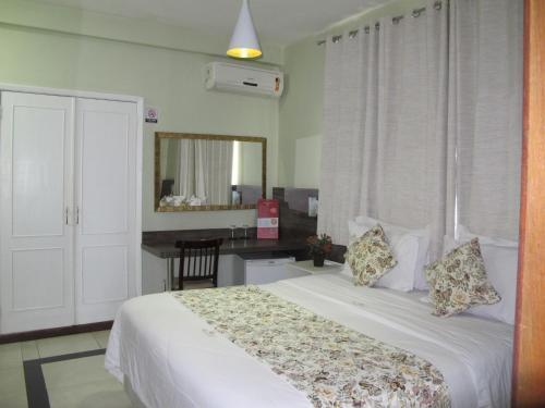 Cama ou camas em um quarto em Princesa Isabel Pousada e Hotel – Dom Pedro