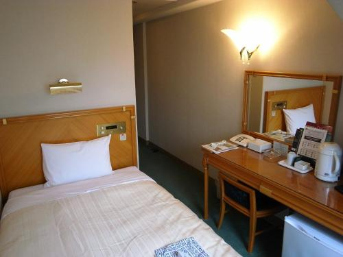 A bed or beds in a room at Hotel Kizankan