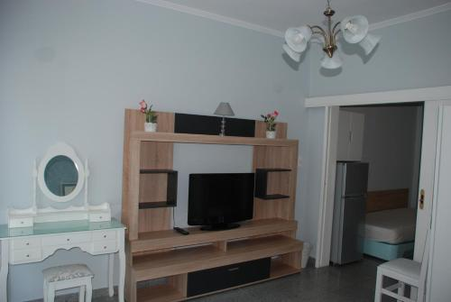A television and/or entertainment center at Diaporos Hotel