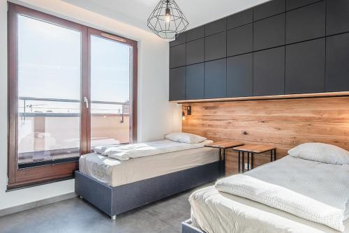Łóżko lub łóżka w pokoju w obiekcie CITYSTAY Chmielna Apartments
