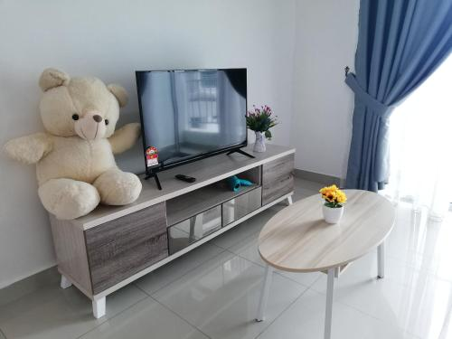 A television and/or entertainment centre at Love&Leisure Homestay 4r3b Opp SPICE Arena Penang
