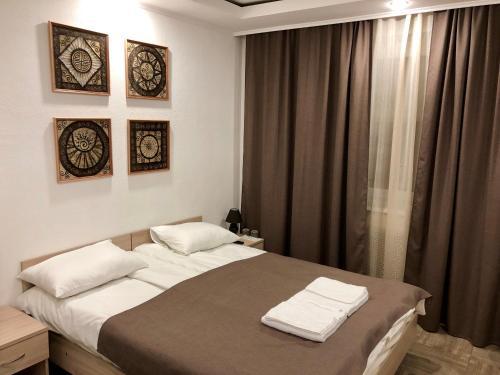 Кровать или кровати в номере Гостевой дом «Павшино»