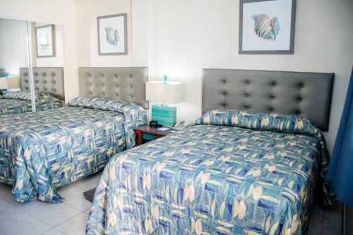 A bed or beds in a room at Villa Cofresi