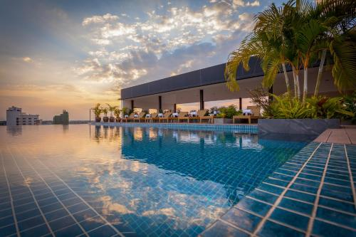 The swimming pool at or near Lao Poet Hotel