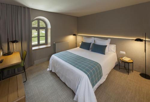 Cama o camas de una habitación en Hotel Vall de Núria
