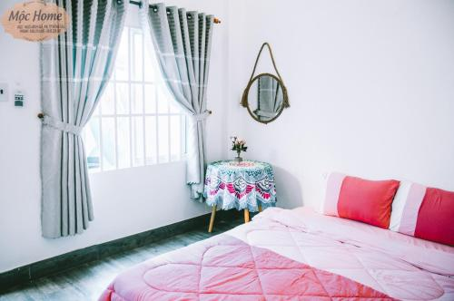 A bed or beds in a room at Mộc Home