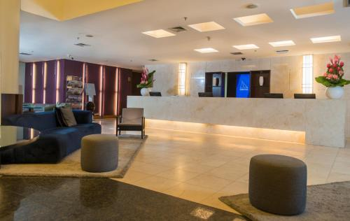 The lobby or reception area at Hotel Luzeiros Fortaleza
