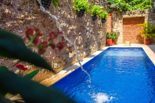 The swimming pool at or near Hotel Casa Castel By GB Collection