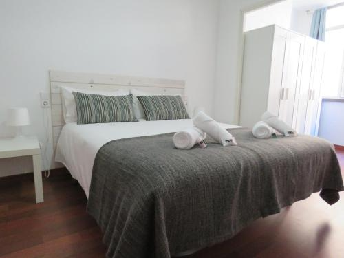 A bed or beds in a room at SUITEDREAMS-Avet 21
