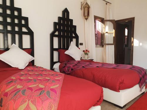 A bed or beds in a room at Jnan El Arif
