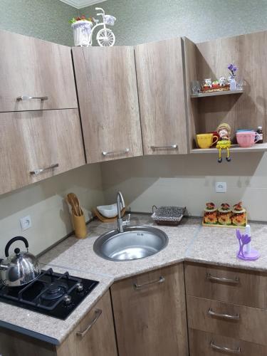 A kitchen or kitchenette at Ananiko