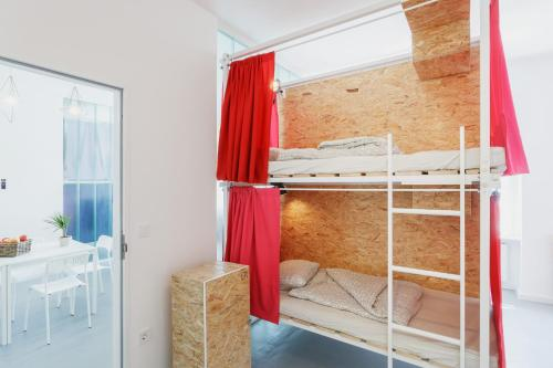 A bunk bed or bunk beds in a room at Avenue Hostel