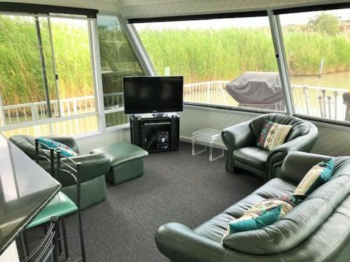 A seating area at The Dove Houseboat
