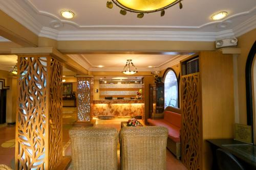 The lobby or reception area at Hotel La Corona Manila