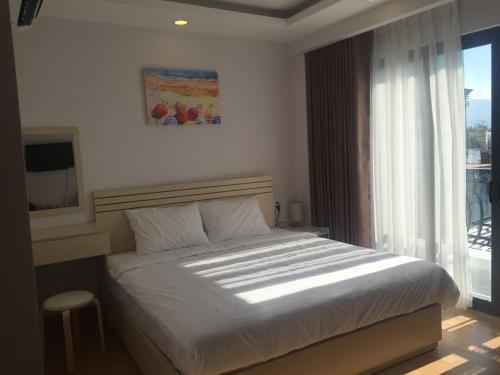 Giường trong phòng chung tại Vanilla Home Sweet Home