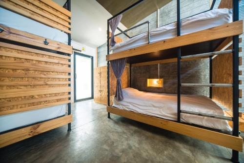 A bunk bed or bunk beds in a room at ChillHub Hostel Phuket