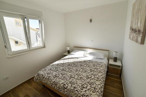 A bed or beds in a room at Apartments Boomerang