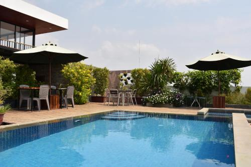 The swimming pool at or near Everland Boutique Hotel
