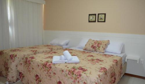 A bed or beds in a room at Hotel Paradouro