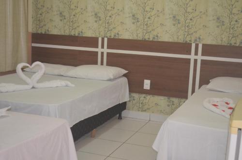 A bed or beds in a room at Hotel Juruá