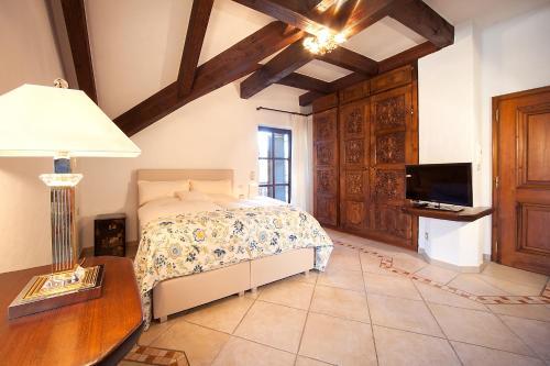 Ein Bett oder Betten in einem Zimmer der Unterkunft Romantik Villa