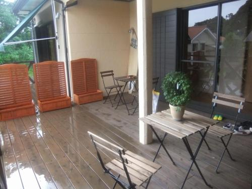 A porch or other outdoor area at HEARTLAND HOUSE - Female Only & Couple Only