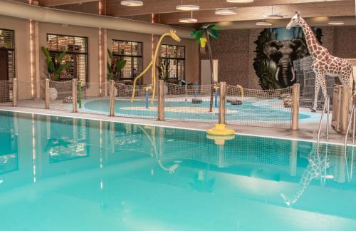 The swimming pool at or near Safari Resort Beekse Bergen