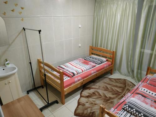 A bed or beds in a room at VIVA Hostel