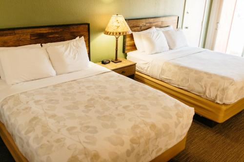A bed or beds in a room at Brown County Inn