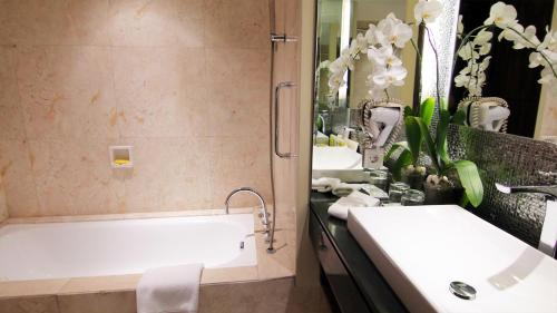 A bathroom at The Arista Hotel Palembang