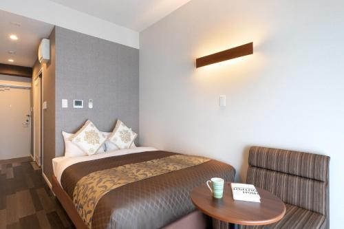 Cama o camas de una habitación en Mr. Kinjo in Motobu