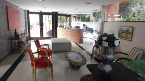 The lobby or reception area at Pousada Charme Fonte do Boi