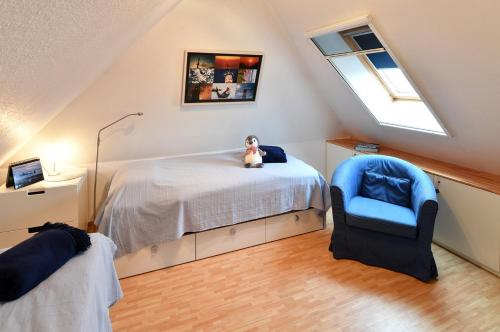 A bed or beds in a room at Haus Hamburg