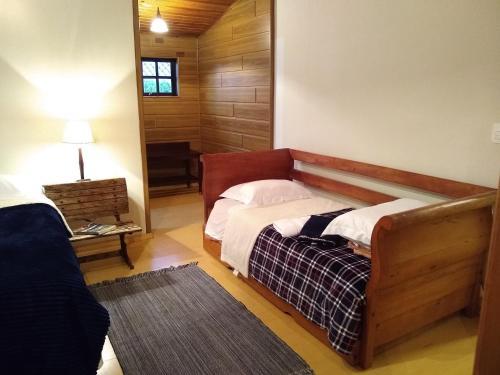 Cama ou camas em um quarto em Entre Vilas Lodge