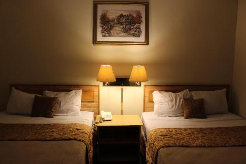A bed or beds in a room at Hotel Mediterraneo Plaza
