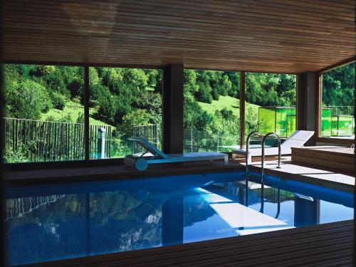 The swimming pool at or near Hotel Santa Cristina Petit Spa