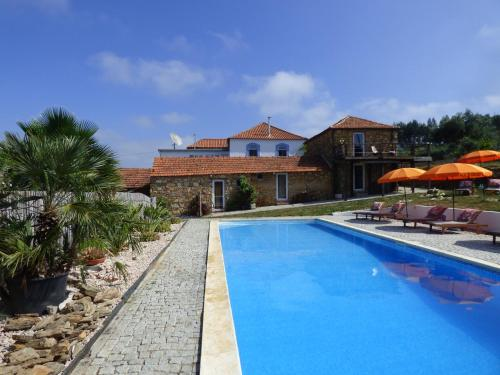 The swimming pool at or near Quinta d'Alegria with large swimming pool near Coimbra