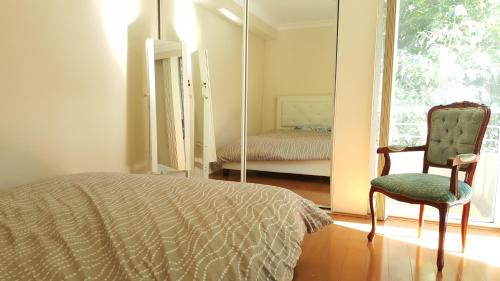 A bed or beds in a room at FURNISHED 2BR by HARBOURSIDE