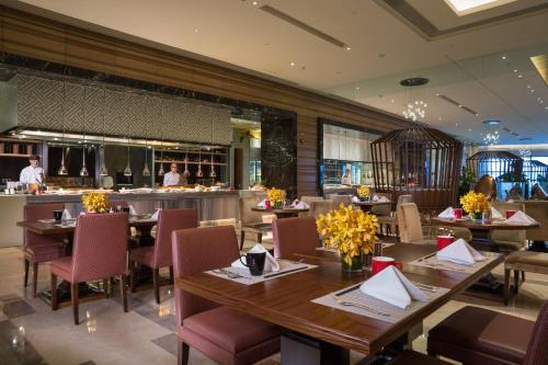 A restaurant or other place to eat at Hilton Urumqi