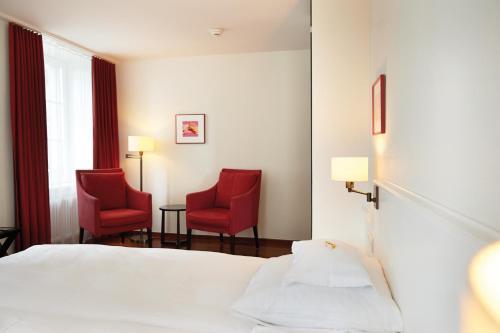 Ein Bett oder Betten in einem Zimmer der Unterkunft Boutique Hotel Helmhaus Zürich