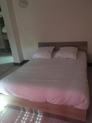 Un ou plusieurs lits dans un hébergement de l'établissement HERITAGE Le Marandais