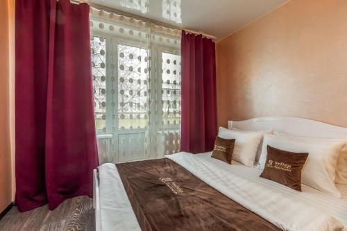 Кровать или кровати в номере InnDays on Belyaevo 110
