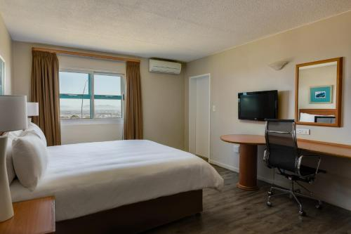 A television and/or entertainment center at Protea Hotel by Marriott Cape Town Tyger Valley