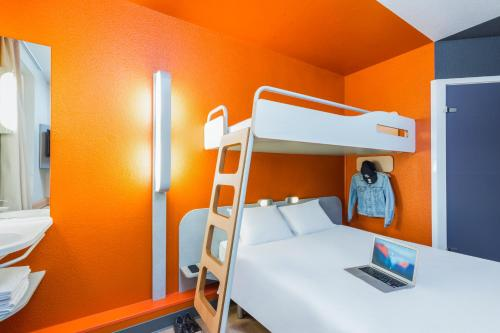 A bunk bed or bunk beds in a room at ibis budget Paris Porte De Montmartre