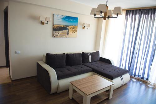 O zonă de relaxare la Arlequin Apartments