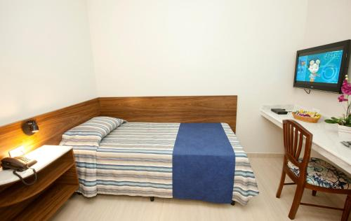 Cama ou camas em um quarto em Hotel Colonial Plaza