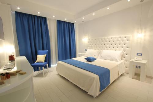 A bed or beds in a room at Ludwig Boutique Hotel