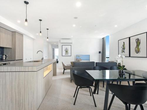 A kitchen or kitchenette at Qube Broadbeach - Luxury 2 Bedroom Ocean View